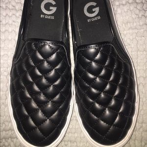 Black slip on guess shoes.